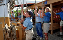 Mystic, CT: Crew Pulling Rope on Whaling Ship Stock Image