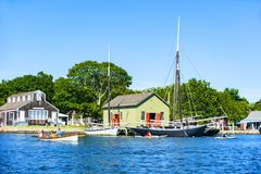 At the Mystic Seaport. Mystic, CT, USA - July 6, 2014: People enjoy a sunny day at the Mystic Seaport. Mystic is one of Connecticut primer destinations royalty free stock photo