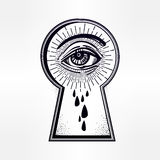 Mystic eye peeping through the keyhole. Stock Photos