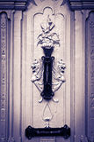Mystic figures carved door, with knocker, black & white. Mystic figures carved door, with black knocker, black & white Royalty Free Stock Photography