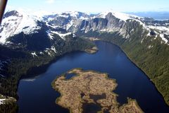 Mystic fjords. Water landscape with blue skies from a plane in Ketchikan Alaska Royalty Free Stock Photography