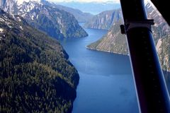 Mystic fjords. Water landscape with blue skies from a plane in Ketchikan Alaska Stock Images