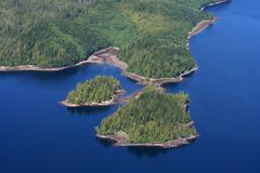 Mystic fjords. Water landscape with blue skies from a plane in Ketchikan Alaska Royalty Free Stock Images