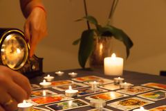 Mystic fortune-telling with fired candles and playing cards stock photo