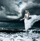 Mystic Goddess in Stormy Sea Royalty Free Stock Image