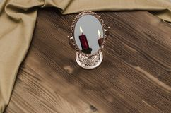 Mystic gold mirror with candle reflection. royalty free stock photo