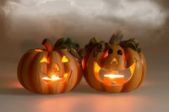 Mystic halloween background. Halloween pumpkins with burning candles Royalty Free Stock Images