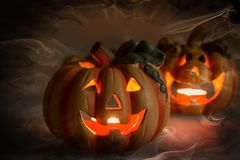Mystic halloween background. Halloween pumpkins with burning candles Royalty Free Stock Photos