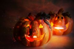 Mystic halloween background. Halloween pumpkins with burning candles Royalty Free Stock Photo