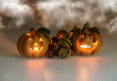 Mystic halloween background. Halloween pumpkins with burning candles Stock Photography