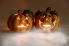 Mystic halloween background. Halloween pumpkins with burning candles Stock Photo