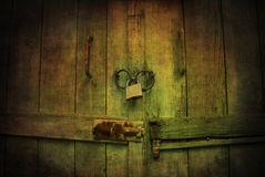 Mystic locked wooden gate. Mystic wooden gate with padlock Royalty Free Stock Photo