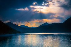 Mystic mood at austrian lake with clouds Stock Images