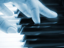 Mystic piano music cover photo. Cover photo for your books and wallpaper requirements with piano keys closeup being played by mystic bluish hands with an royalty free stock image
