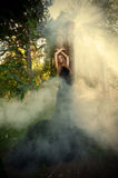 Mystic portrait of young woman in the forest ruins stock photos