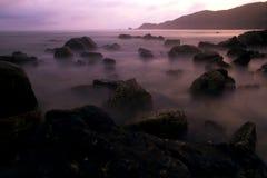 Mystic rocks in the ocean. On the beach of Kuta, Lombok, Indonesia Stock Image