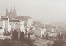 Romantic view on Praga from above. Sepia toned card in vintage retro style royalty free stock image