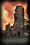 Mystic, ruined witch tower. Against red wild sky royalty free illustration