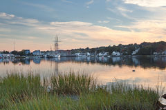 Mystic Seaport, CT. Historic Mystic Seaport in Connecticut, just seconds after sunset Royalty Free Stock Images