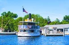 In the Mystic Seaport. Mystic, CT, USA - July 6, 2014: Boat makes its way along the Mystic River. Mystic is one of Connecticut primer destinations stock photo