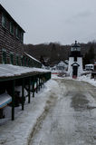 Mystic Seaport Light. Is a lighthouse at the south end of Mystic Seaport, 2 miles (3.2 km) upriver from Noank, Connecticut. The light is a two story white Stock Photos