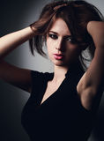 Mystic sexy young woman holding hair the hands and looking hot w Stock Images