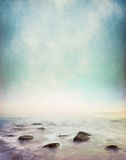 Mystic Shore. Mist and fog rising from a rocky ocean shore. Image has a vintage paper texture and displays a pleasing grain pattern at 100 stock image