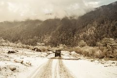 Mystic snow covered forest road leading through lush foliage, from Sonmarg To Gulmarg to Srinagar, Pahalgam, in Kashmir royalty free stock photo