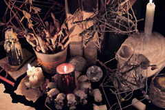 Mystic still life with evil candles and skull. Halloween concept, black magic ritual or spell with occult and esoteric symbols, divination rite. Vintage stock images