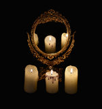 Mystic still life with mirrow and three burning candles. Mystic still life with mirror, reflection and three burning candles. Halloween concept, black magic royalty free stock photos