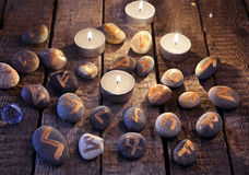 Mystic still life with stone runes and candles. Halloween background, black magic rite or spell, occult and esoteric objects on witch table royalty free stock image