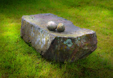 Mystic stones. One big flat stone with two small round stones royalty free stock images