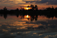 Mystic summer sunset over lake Royalty Free Stock Images