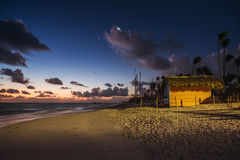 Mystic sunrise with moon and stars over the sandy beach in Punta Royalty Free Stock Image