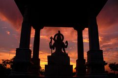 Mystic sunset. The silhouette of Hindu God Shiva's statue near Birla temple at Jaipur, taken against very colourful mystic sky at sunset. Birla Temple forms one Royalty Free Stock Photo