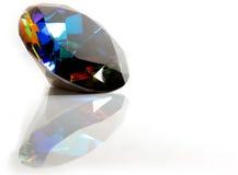 Mystic Topaz Gemstone. Round cut faceted Mystic Topaz gemsone on white background with reflection Royalty Free Stock Photo