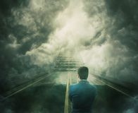 Mystic stairway. Mystic view as a man stand on the road transforming into a stairway going up to unknown heaven. Difficult decision, concept of the important Royalty Free Stock Photo