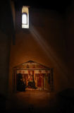 Mystic view in a church. Inside a church. Fresco painting under a beam of light from a window Stock Images