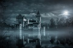 Mystic Water castle in moonlight. Spooky stock image