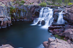 Mystic Waterfall Pool. Pretty alpine waterfall in Northern California with motion blurred water cascade into calm pool Stock Images