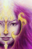 Mystic woman face with gold ornamental tattoo and two phoenix birds, purple background. eye contact. Stock Image