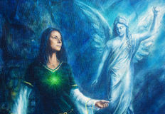 Mystic woman  in historical dress with ornament and angel. Spiritual concept. Painting on canvas with abstract blue background. Mystic woman  in historical Stock Images