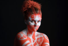 Mystic young woman with painted face Royalty Free Stock Photos