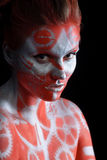 Mystic young woman with painted face Royalty Free Stock Photo