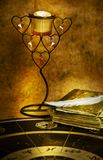 Mystical astrology. Astrological horoscope with old book, feather and candlestick in mystical lightning royalty free stock photos