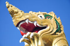 Mystical beast, Singha, under blue sky Royalty Free Stock Photos
