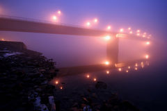 Mystical bgidge in fog Royalty Free Stock Images