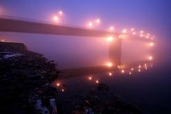 Mystical bgidge in fog. Mystical spooky bridge on a danube river royalty free stock images