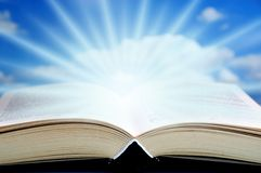 Mystical book. Open book with mystical rays of light coming out of it royalty free stock images