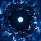 Mystical bright full moon in the midnight sky with stars surrounded by dramatic clouds. Dark background with night sky moon. Mystical bright full moon in the royalty free stock photography